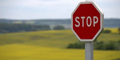 stop sign in pasture